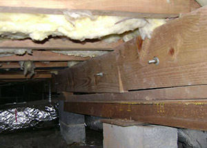 sagging crawl space with wooden shimming a Columbus crawl space